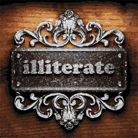 illiterate: iron word on wooden background