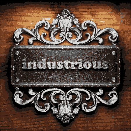 industrious: iron word on wooden background