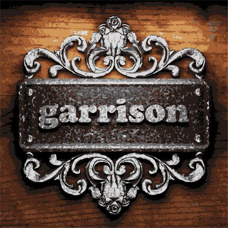 garrison: iron word on wooden background