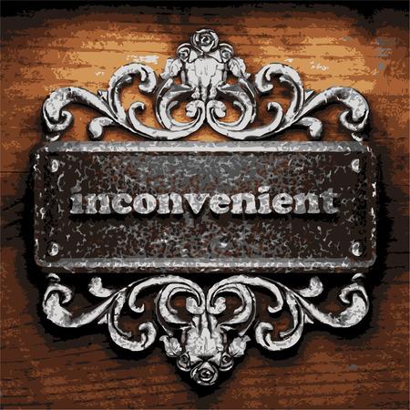 inconvenient: iron word on wooden background