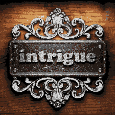 intrigue: iron word on wooden background