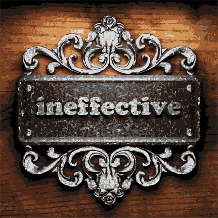 ineffective: iron word on wooden background