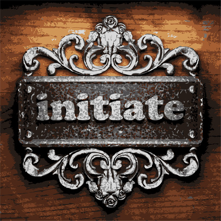 initiate: iron word on wooden background