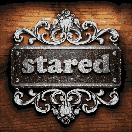 stared: vector iron word on wooden background