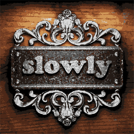 slowly: vector iron word on wooden background