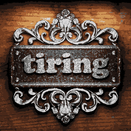 tiring: vector iron word on wooden background