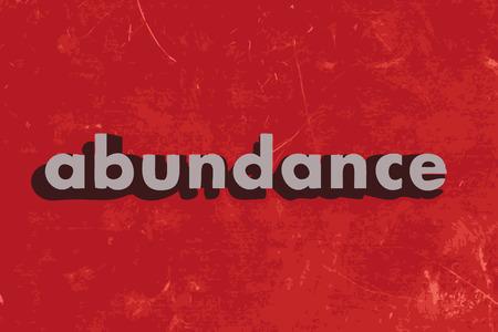 abundance: abundance vector word on red concrete wall