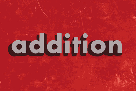 addition: addition vector word on red concrete wall