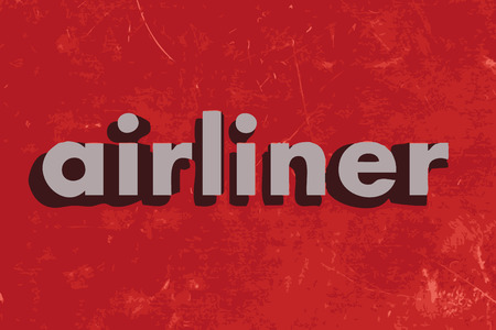 airliner: airliner vector word on red concrete wall