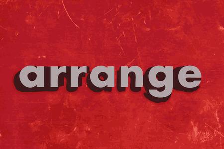 arrange: arrange vector word on red concrete wall