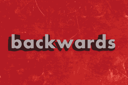 backwards: achteruit vector woord over rode betonnen muur