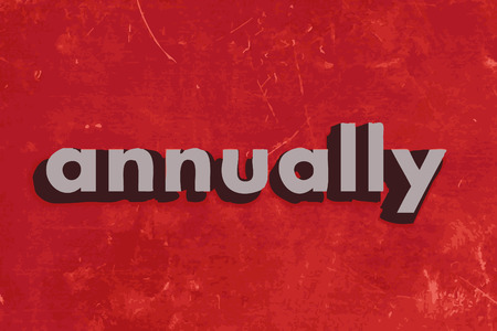 annually: annually vector word on red concrete wall