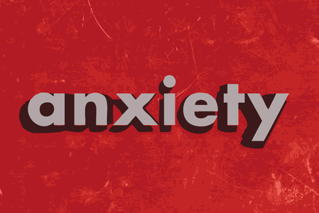 anxiety: anxiety vector word on red concrete wall