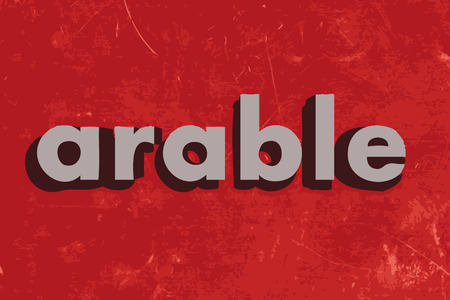 arable: arable vector word on red concrete wall Illustration