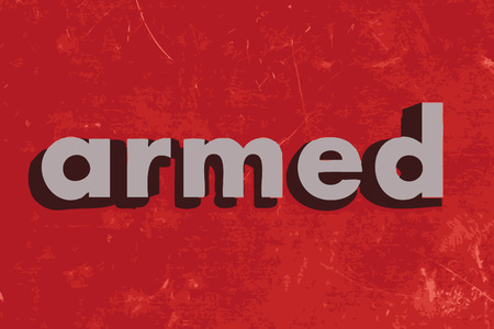 armed: armed vector word on red concrete wall