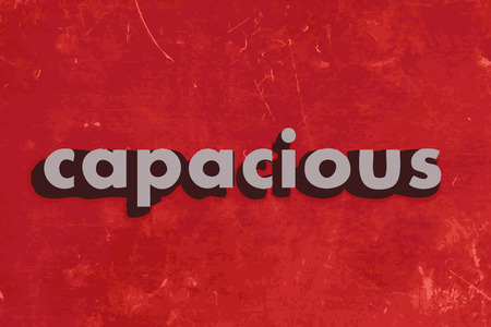 capacious: capacious vector word on red concrete wall