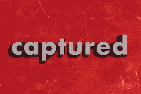 captured: captured vector word on red concrete wall Illustration