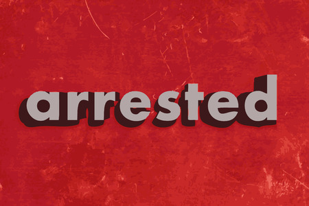 arrested: arrested vector word on red concrete wall