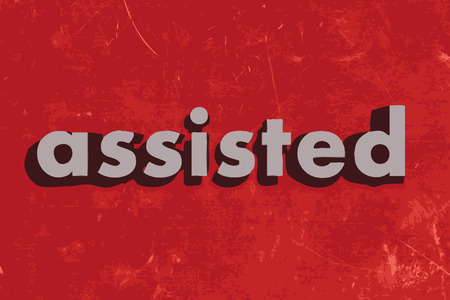 assisted: assisted vector word on red concrete wall