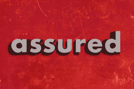 assured: palabra vector asegurada en rojo muro de hormig�n