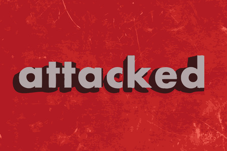 attacked: attacked vector word on red concrete wall
