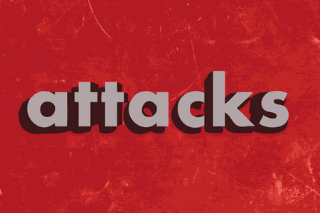 attacks: attacks vector word on red concrete wall