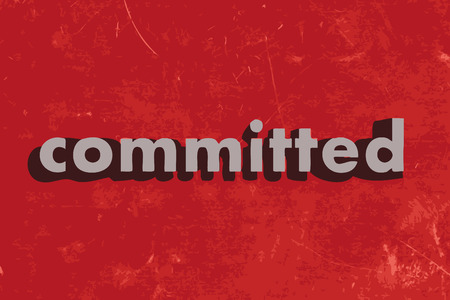 committed vector word on red concrete wall
