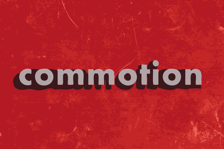 commotion: commotion vector word on red concrete wall