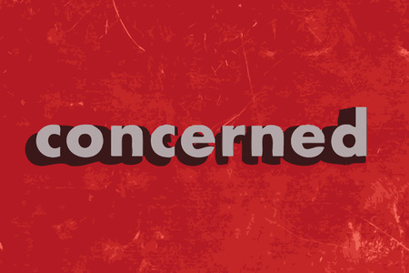 concerned: concerned vector word on red concrete wall