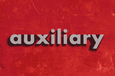 auxiliary: auxiliary vector word on red concrete wall