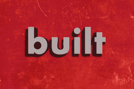 built: built vector word on red concrete wall
