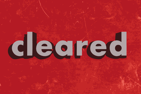 cleared: cleared vector word on red concrete wall