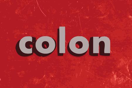 colon: colon vector word on red concrete wall