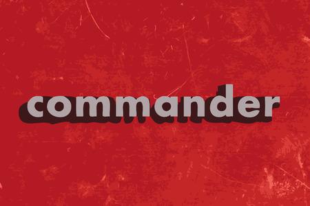 comandante: comandante vettore parola sul muro di cemento rosso