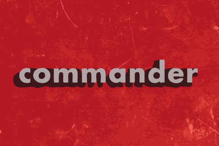 commander: commander vector word on red concrete wall