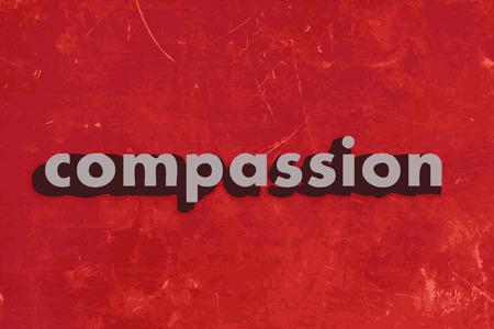 compassione vettore parola sul muro di cemento rosso