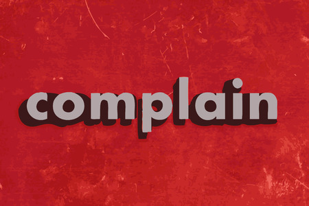 complain: complain vector word on red concrete wall