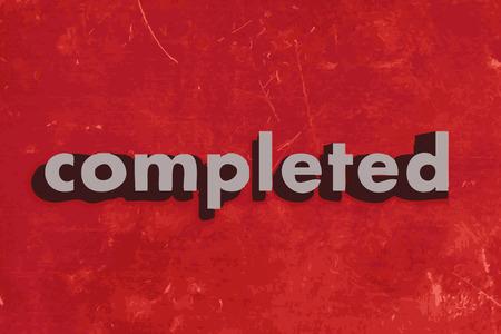 completato: completato parola vettoriale su muro di cemento rosso