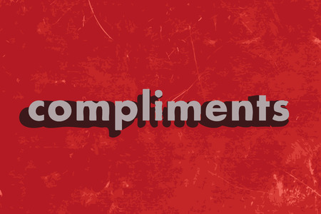 compliments: compliments vector word on red concrete wall