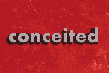 conceited: conceited vector word on red concrete wall