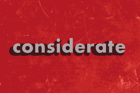 considerate: considerate vector word on red concrete wall