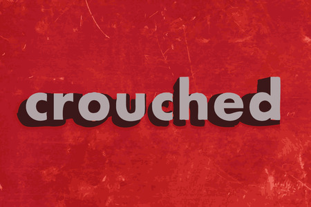 crouched: crouched vector word on red concrete wall