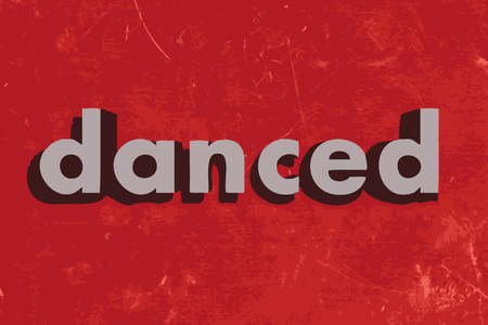 danced: danced vector word on red concrete wall