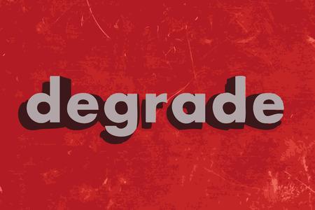 to degrade: degradar palabra vector en rojo muro de hormig�n