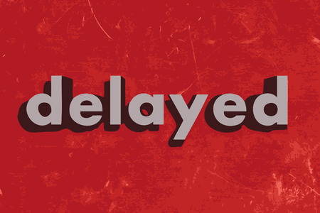delayed: delayed vector word on red concrete wall