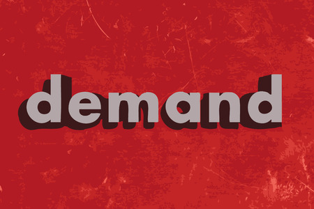 in demand: demand vector word on red concrete wall