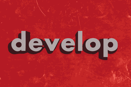 develop: develop vector word on red concrete wall