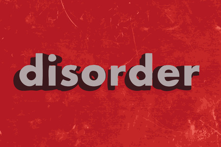 disorders: disorder vector word on red concrete wall
