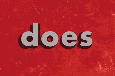 does: does vector word on red concrete wall