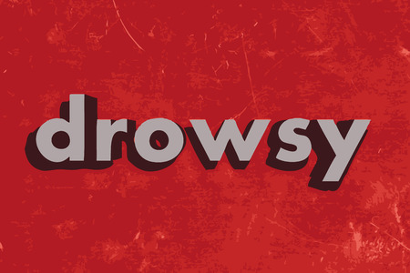 drowsy: drowsy vector word on red concrete wall